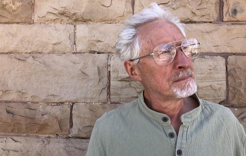 Jim Mischke poses for a portrait outside of KSJD.