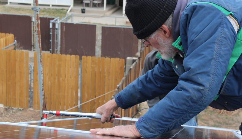 Chuck Haspels works on one of the solar panels going on his Cortez home. Solar Barn Raising promotes a do-it-yourself process that includes and educates homeowners in the process.