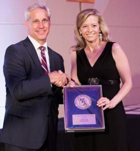KSMU's Jennifer Davidson (right) accepts her award for news series from John Zimmer, former chairman of the MBA Board, on June 7.