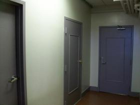 These doors inside the Harmony House domestic violence shelter lead to rooms where abuse victims find safety.