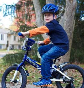 Boy Wears a Helmet While Riding a Bike