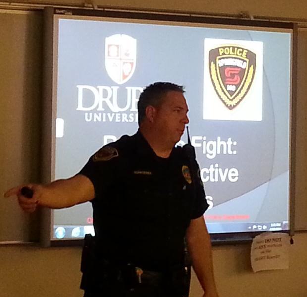 Officer Eric Schroeder giving his presentation at Drury Thursday/Credit: Scott Harvey
