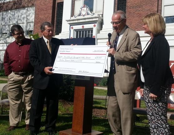 SPS receives $14,000 check from Central Christian Church (L-R: Pastor John Andrews, Greg Walton, Superintendent Dr. Norm Ridder,