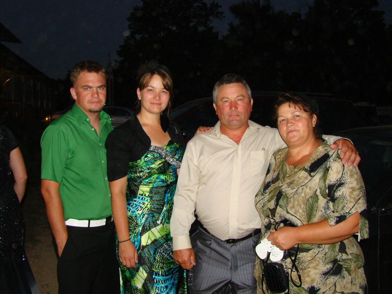 Anastasia Gantyuk, second from left, with her family after a wedding at the Russian Church just north of West Plains, Missouri.
