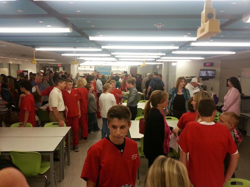 Health Sciences Academy students, dressed in red scrubs, along with their parents, attend an open house of the 6,500 square foot complex following Wednesday's ribbon cutting.