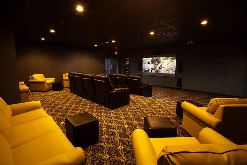 Movie theatre inside Bear Village clubhouse.