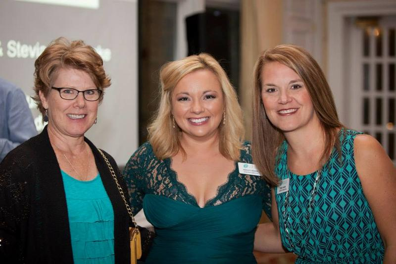 GYN Cancers Alliance Assistant Director Ashley Berry is flanked by GYNCA supporters at a recent Alliance fundraiser