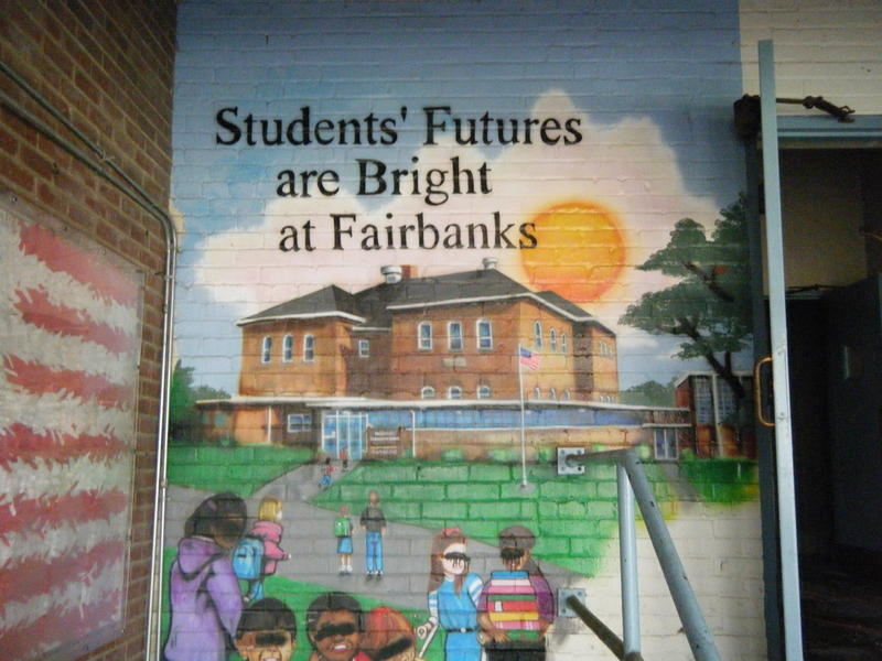 One of the original elementary school murals that survived grafitti and will remain part of the new atmosphere.