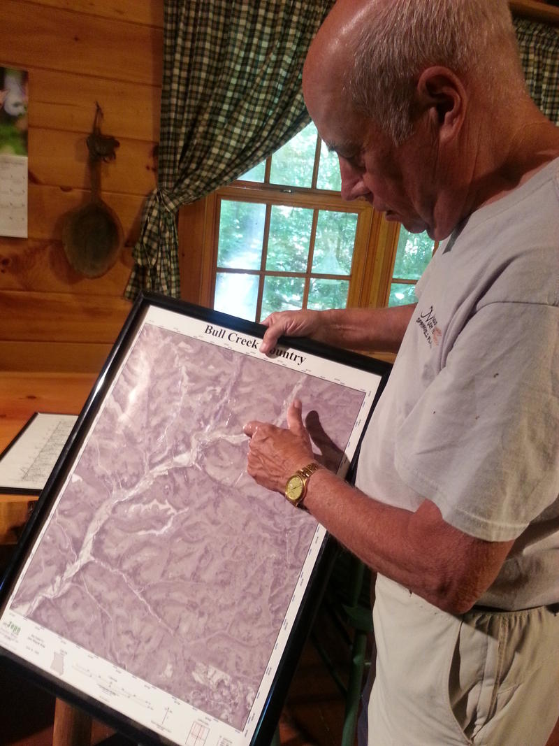 Bob Kipfer points out a map of Bull Mills Country