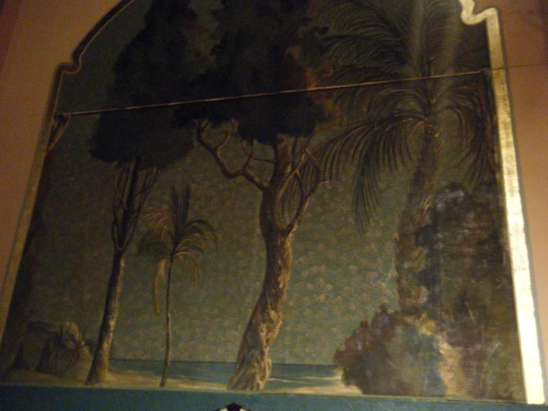 One of the many murals that line the walls of each side of the theatre.  Rediscovered during rennovations and originally painted in the late 20s early 30s.