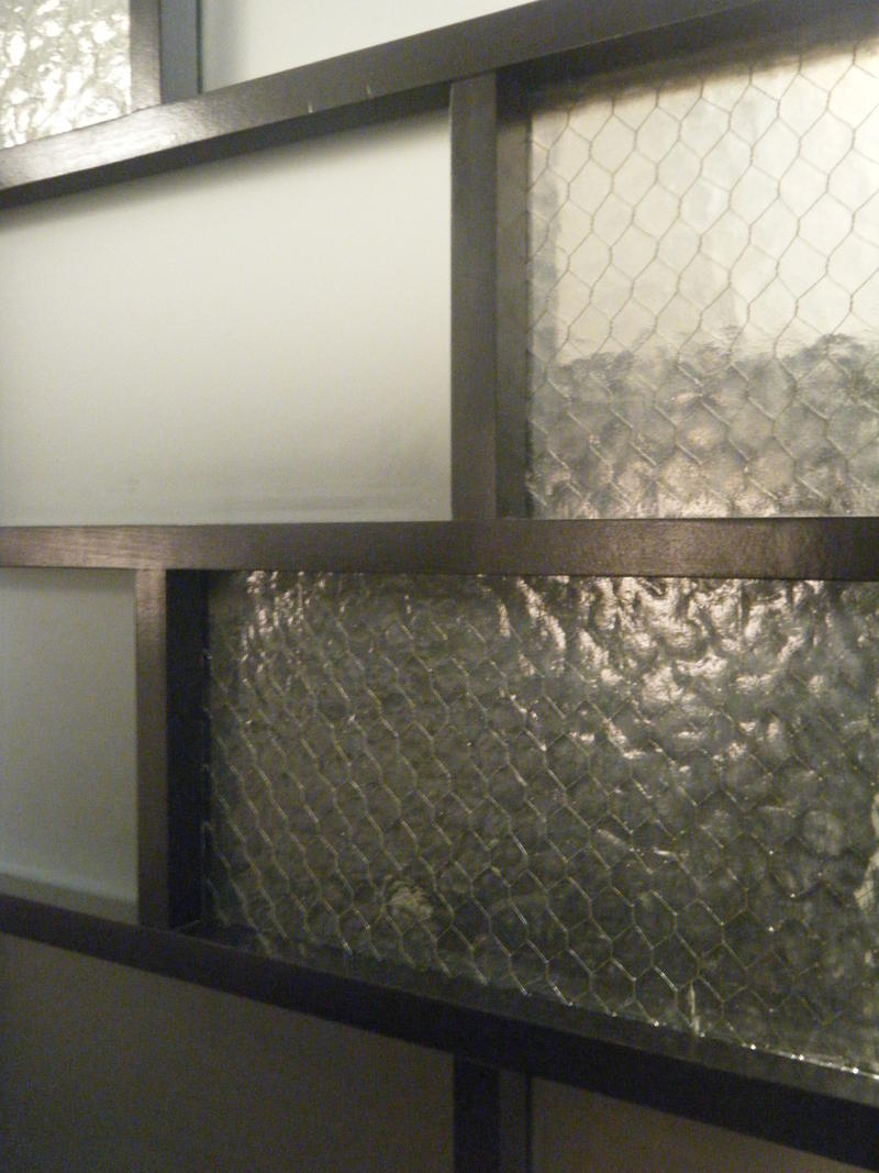 A room divider hand crafted using 100 year old original glass.