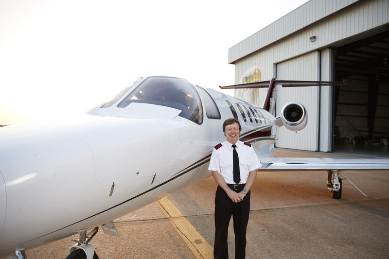 Mark Burgess standing next to his charter plane.