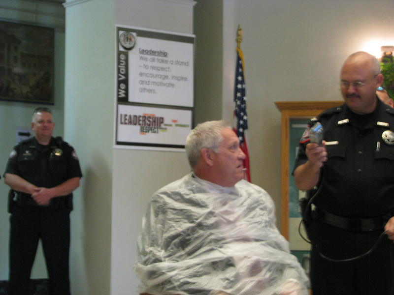 Commissioner Bob Cirtin Looks Warily at Sheriff Jim Arnott