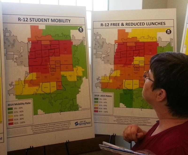 """Citizens examine data charts Thursday that city officials presented during this summer's """"Zone Blitz"""" or Community Listen Sessions."""