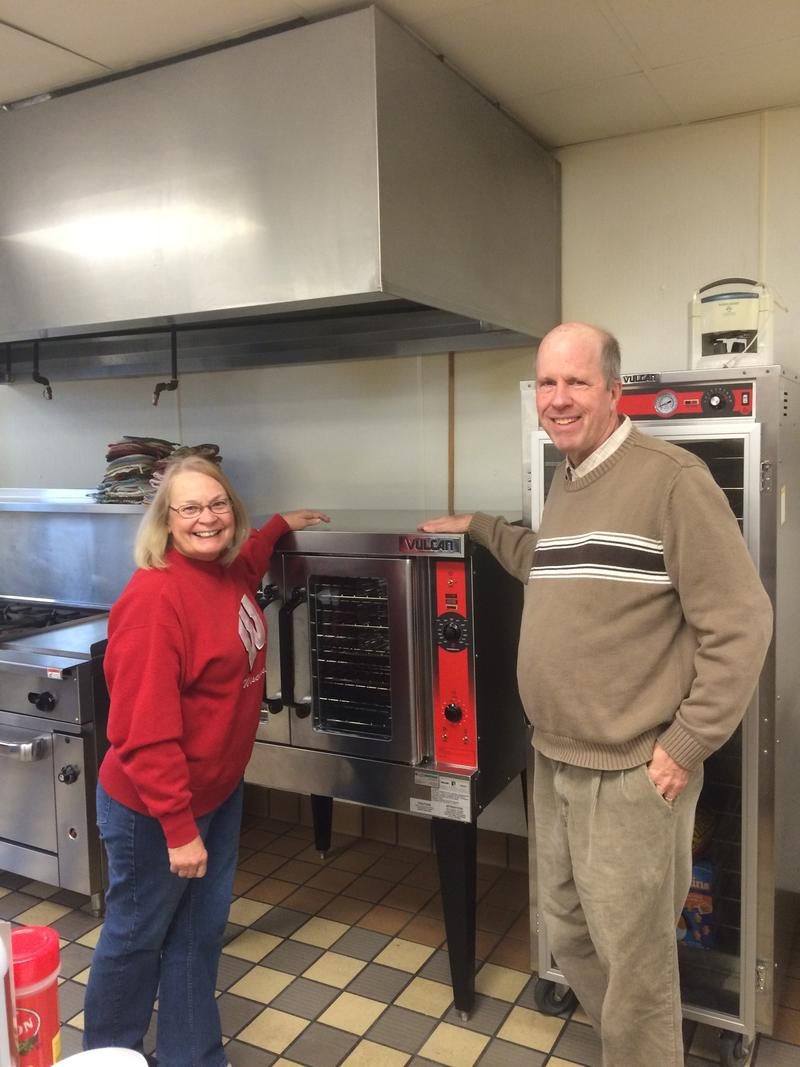 CCC Co Directors Marilyn and Brian Bisbee With a Newly Donated Convection Oven