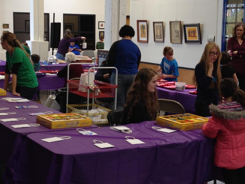 Kids, volunteers and art supplies.