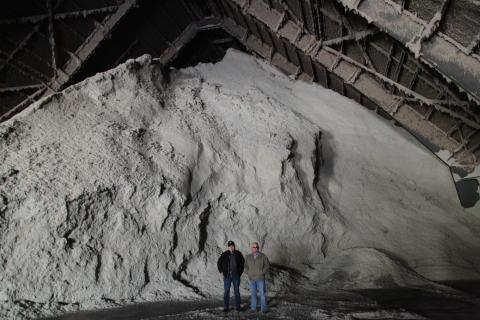 Cotton grower Charles Parker, left, stands in front of a pile of cottonseed in Senath, Missouri.
