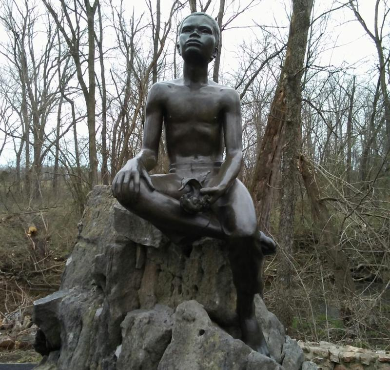 The Boy Carver statue sits along the one-mile, self guided trail loop at Carver National Monument.
