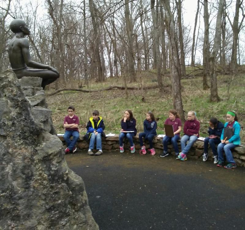 Students with Grace Classical Academy from Springfield observe the Boy Carver statue during their tour.