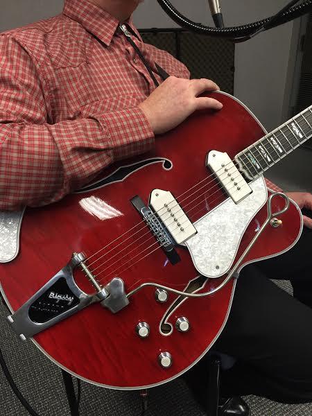 A close up of Randy Buckner's custom Merle Travis-style guitar