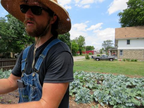 Neil Rudisill grows dozens of crops and raises chickens on a small plot in the heart of Kansas City, Missouri.
