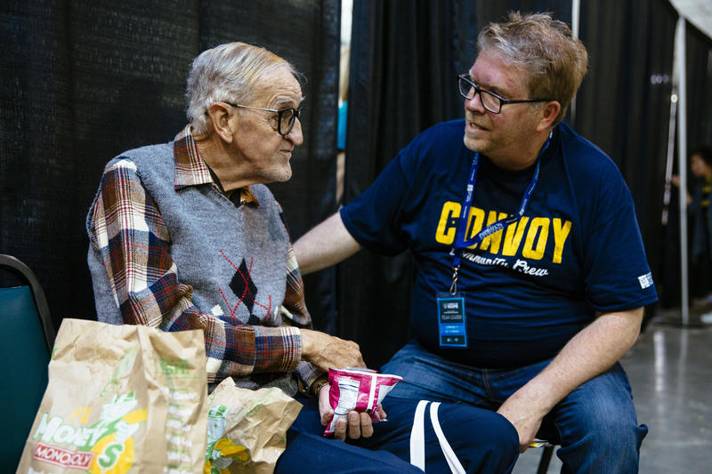 Volunteer talking to an elderly man