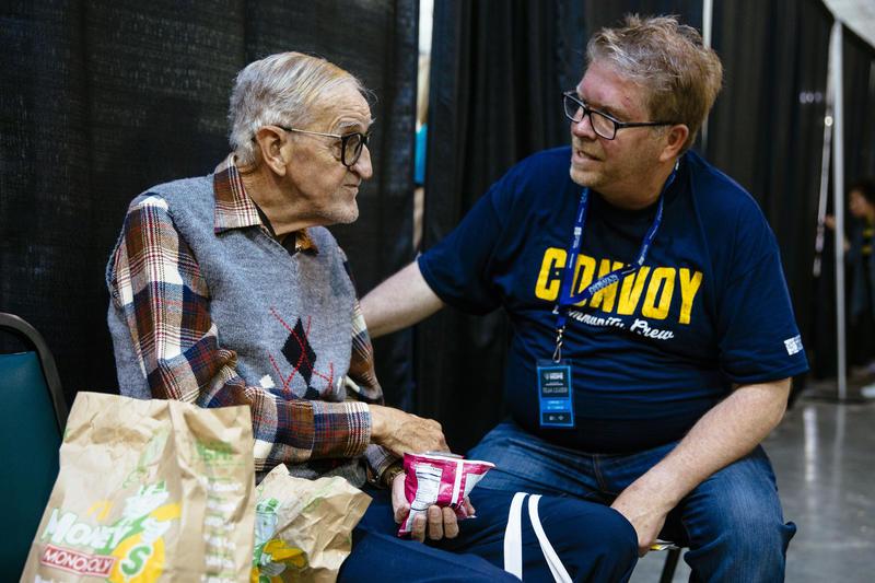 Volunteer talking to an elderly man