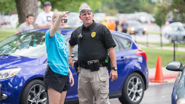 Student talking to police officer