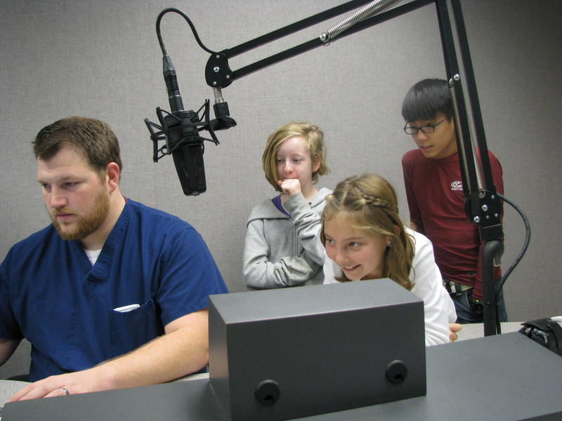 Rountree Elementary students (Left to right: Cricket Sadler, Ulali Benltey, and Jonah Martin) help edit their episode of the Rountree News Update