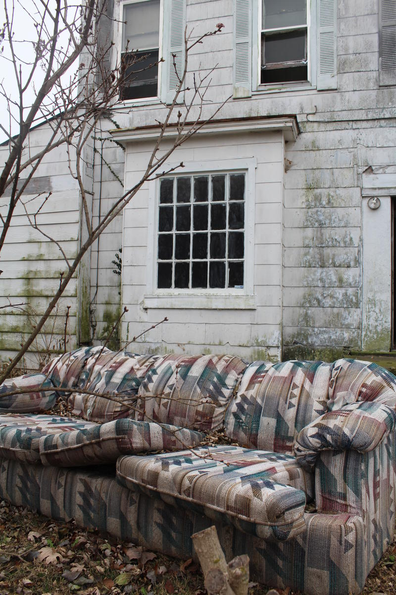 Couch in Yard of House on W. Hamilton