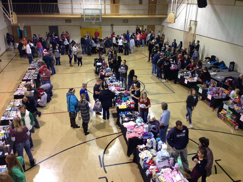 Parents and guardians of some 340 children select Christmas gifts for the kids in the gymnasium of the Dream Center.