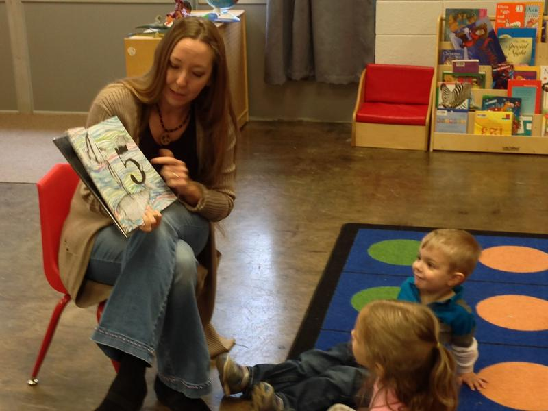 Artist Cory Leick reads a book with pre-schoolers in her Mini Monet class at The Fairbanks.