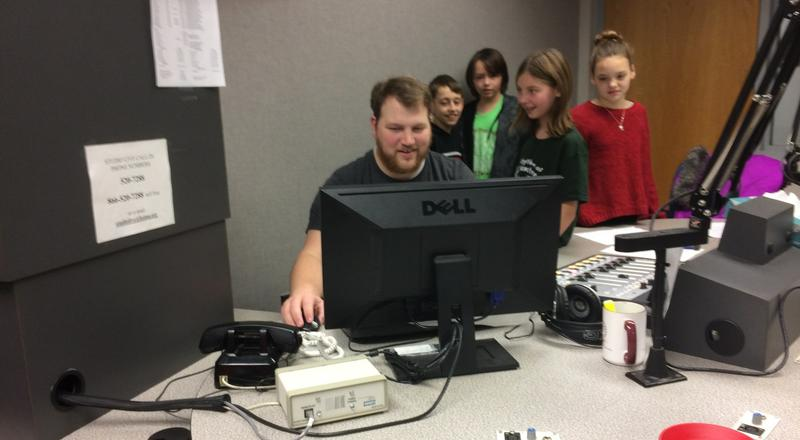Rountree Elementary Students (Left to right: Kaden Herring, Jakob Sheppard, Lali Bentley, and Annie Beatty) watch on as their episode is edited by engineer Peter Batemon