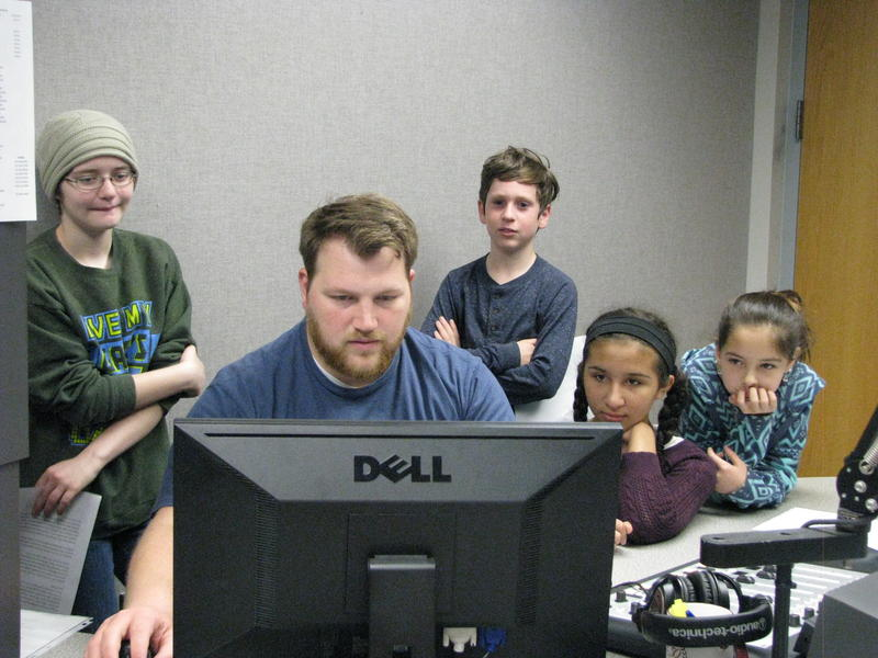 Students (Left to Right: Rebeka Quaethem, Arthur Smith, Elana Hadi, and Serenity Hefley-Conner) look on as their episode is edited for the air.