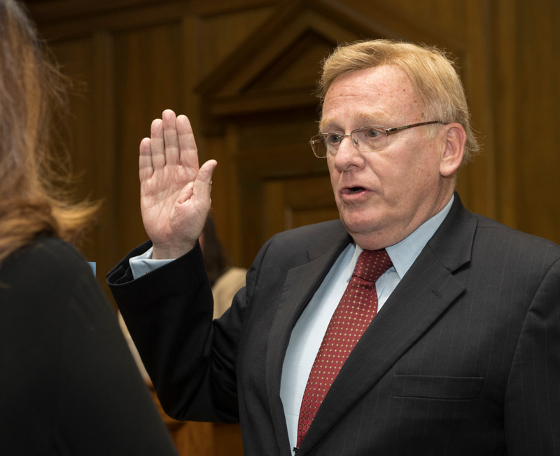 Ken McClure taking the oath of office Tuesday