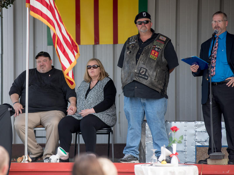 Kerry Miller, far right, speaks to the crowd about sacrifice during the unveiling of Special Agent Joseph M. Peters Hero's Way Highway sign.