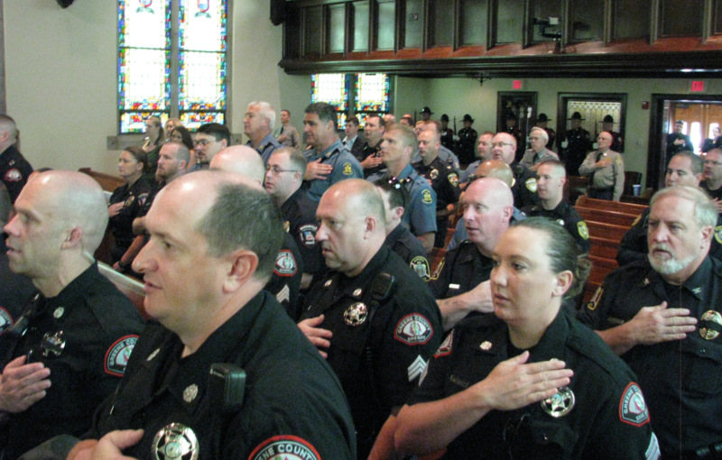 Law enforcement gather at First & Calvary Presbyterian Church for the Peace Officers Memorial Service Thursday