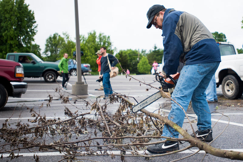 David Pryor, of Phelps Grove, cuts a large branch into smaller pieces so that they can be easier to manage as part of the cleanup. Phelps Neighborhood Association held a neighbor cleanup day for Phelps Grove from 8 a.m. to 12 p.m. on May 20, 2017.