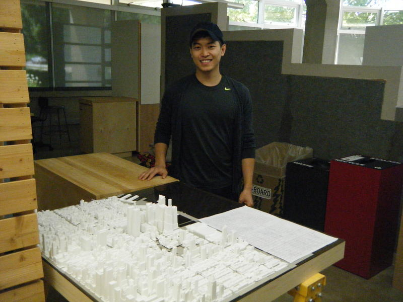 Recent graduate-Youngsoo Yang standing by his Manhattan skyline
