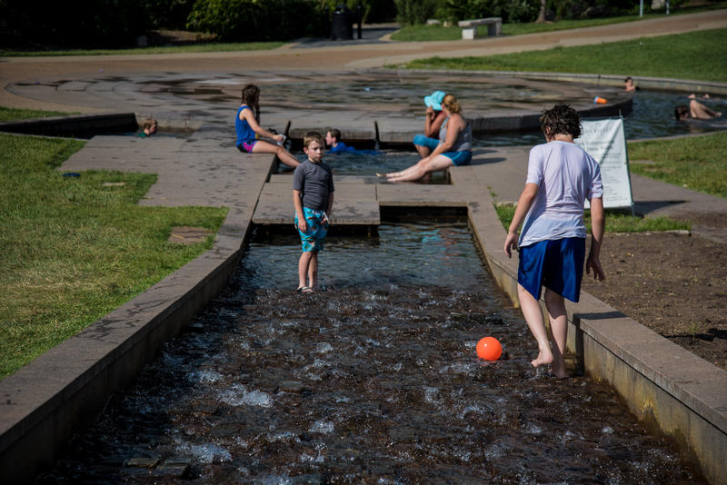 Children play in the Jordan Valley Fountain as temperatures reached 95 degrees Wednesday July 12.