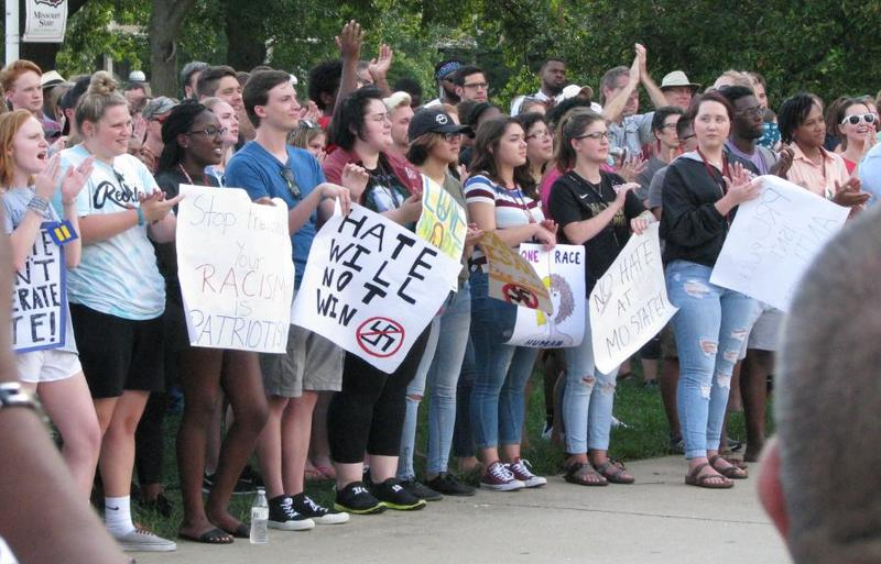 Participants display signs combatting racism during Monday's rally at MSU