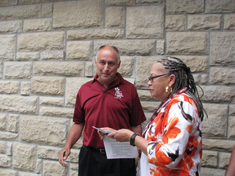 Steve Wiemer, Owner of Enterprise Park Lanes, Talks With Cheryl Clay, NAACP Springfield President, After a News Conference