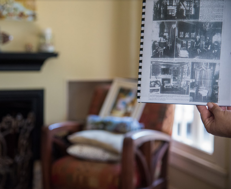 Inside Susan and Brian Camey's home at 1257 E Delmar, with a historical booklet prepared by Richard Crabtree