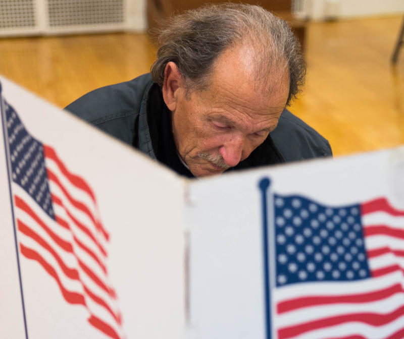 Denton Corbett, 68, votes at the Phelps Center for Gifted Education on election day in Springfield on Nov. 7.