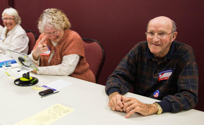 Election officials (right to left) Truman Madders, 89, Rita Silic, 70, and Peggy Wissmueller, 72, laugh together as the wait for voters at the Kenneth E. Meyer Alumni Center on Nov. 7.