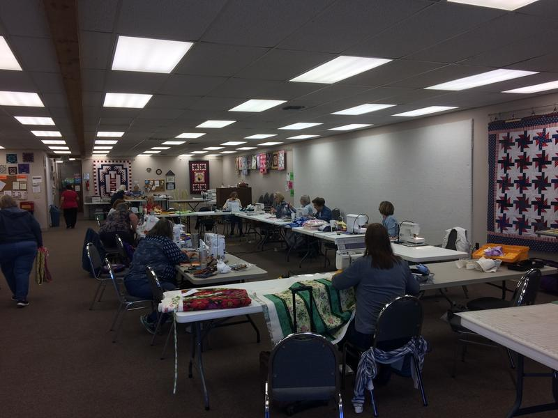 Guild Members Bring a Variety Of Sewing Machines To Make Quilts For The Community