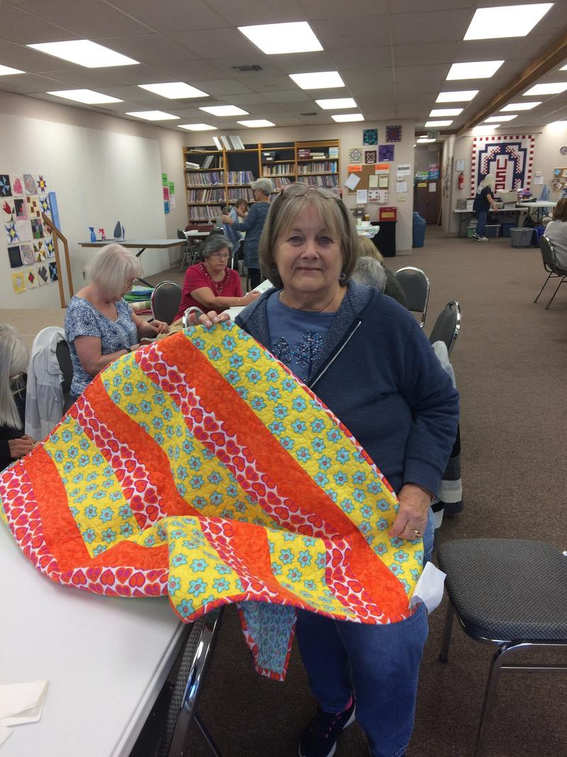 Ozark Piecemakers Quilt Guild Member Marilyn White Puts Final Touches On A Squad Car Quilt