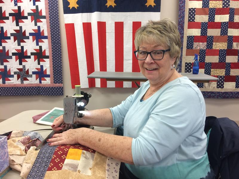 Guild Member Vivian Terbeek With A Log Cabin Quilt For A Veteran