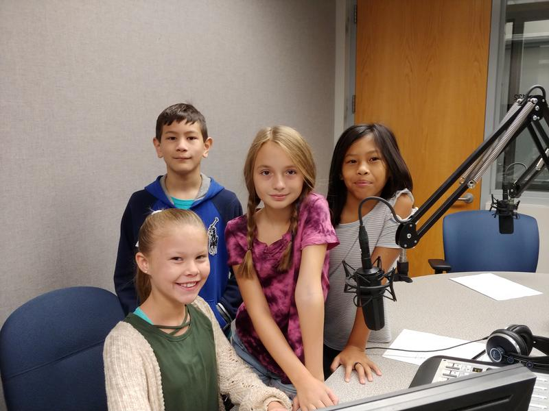 Student from Rountree Elementary School come to KSMU studios to share what is happening at their schools. Pictured above left to right: Themla McWay, Tristan Armstrong, Chariot Ryan, and Leah Barton.