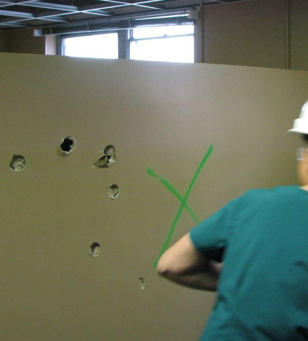 A Student Swings a Hammer to Kick off the Cox College Project